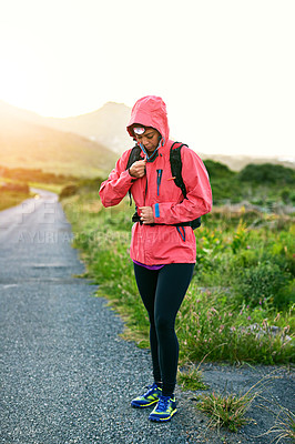 Buy stock photo Shot of a young woman preparing for a run on a cool morning