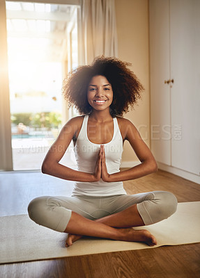 Buy stock photo Full length portrait of a sporty young woman practicing yoga indoors