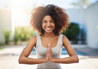 Buy stock photo Cropped portrait of a sporty young woman practicing yoga outdoors