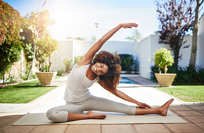 Buy stock photo Full length portrait of a sporty young woman practicing yoga outdoors