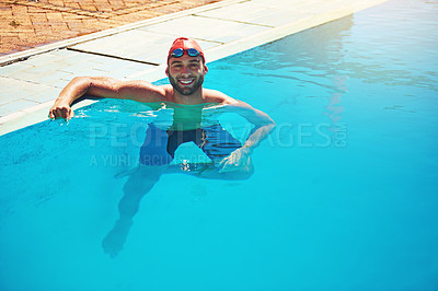Buy stock photo Portrait of an athletic young man in swimwear wading by the edge of a swimming pool