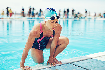 Buy stock photo Shot of an athletic young woman in climbing out of a swimming pool