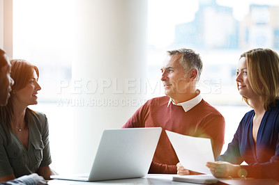 Buy stock photo Shot of a group of smiling coworkers having a meeting in an office