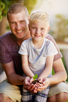 Buy stock photo Portrait of a father and his little son holding a plant growing out of soil