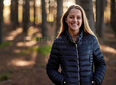 Buy stock photo Portrait of a happy young woman exploring a forest on her own