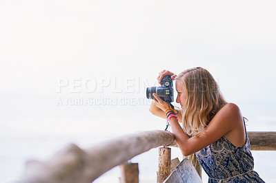 Buy stock photo Shot of a young woman taking pictures while on holiday in Thailand