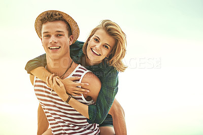 Buy stock photo Cropped portrait of an affectionate young couple enjoying their time on the beach
