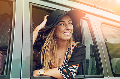 Buy stock photo Portrait of a young woman leaning out the window of a car while on a roadtrip