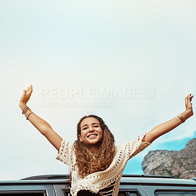 Buy stock photo Cropped shot of a young woman leaning out a car with her arms outstretched while on a roadtrip
