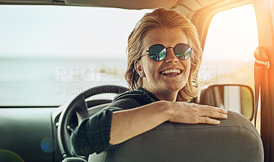 Buy stock photo Portrait of a young woman enjoying a roadtrip