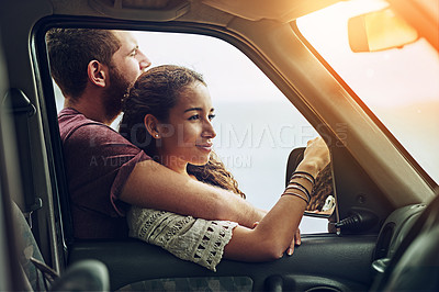 Buy stock photo Cropped shot of a young couple enjoying a roadtrip together