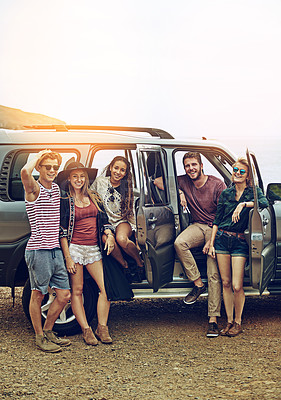 Buy stock photo Portrait of a group of friends enjoying a roadtrip together