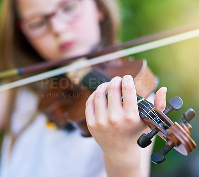 Buy stock photo Cropped shot of a little girl playing the violin outside