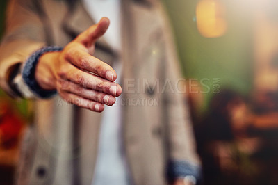 Buy stock photo Cropped shot of an unrecognizable young man extending his arm to shake hands