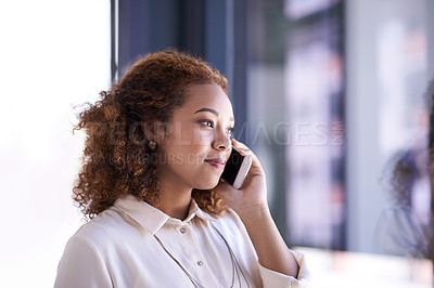 Buy stock photo Shot of a young businesswoman using her mobile phone to make a call at work