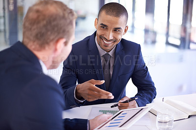 Buy stock photo Cropped shot of businesspeople working together on a digital tablet in an office