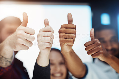 Buy stock photo Cropped shot of a team of colleagues showing thumbs up at work