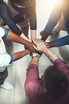 Buy stock photo Cropped shot of a work group joining hands in solidarity