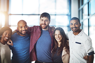 Buy stock photo Portrait of a group of happy young colleagues standing together in a modern office