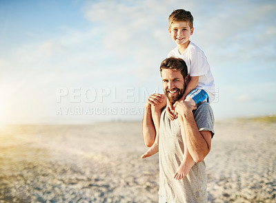 Buy stock photo Portrait of a happy father carrying his son on his shoulders on the beach