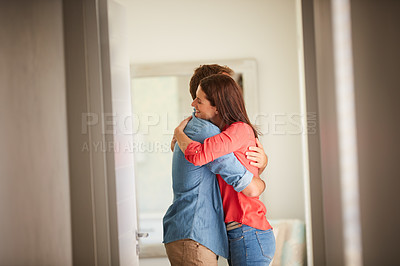 Buy stock photo Shot of an affectionate mature couple bonding together at home