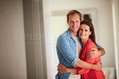 Buy stock photo Portrait of a mature couple relaxing together at home