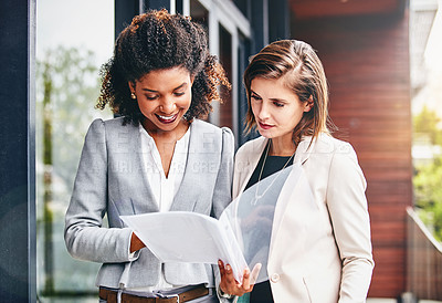 Buy stock photo Cropped shot of two businesswomen having a discussion outside an office