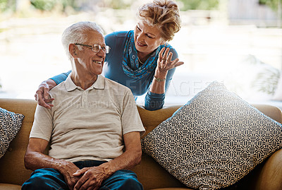 Buy stock photo Shot of a happy couple bonding at home