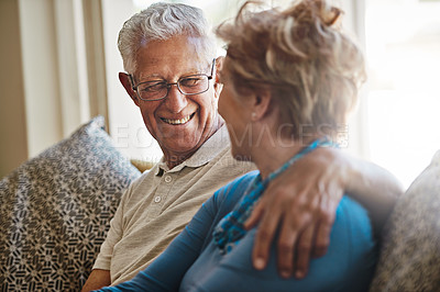 Buy stock photo Shot of a senior couple relaxing together on the sofa at home