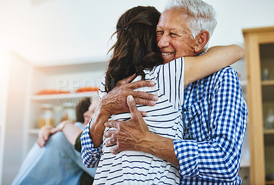 Buy stock photo Cropped shot of a woman hugging her elderly father at home