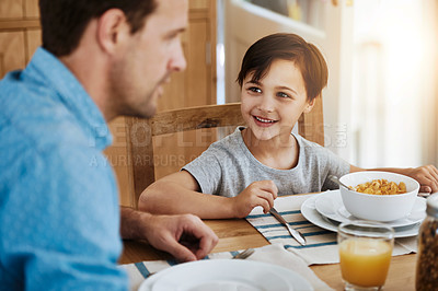 Buy stock photo Cropped shot of a father and his little son having breakfast together at home