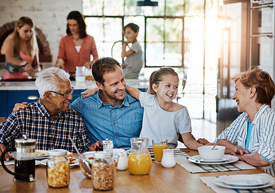 Buy stock photo Cropped shot of a multi generational family enjoying breakfast together at home
