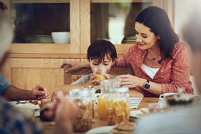 Buy stock photo Cropped shot of a mother and her little son having breakfast together at home