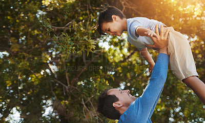 Buy stock photo Shot of a father and his young son spending quality time together outside