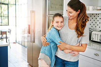 Buy stock photo Portrait of a happy mother and daughter in a loving embrace at home