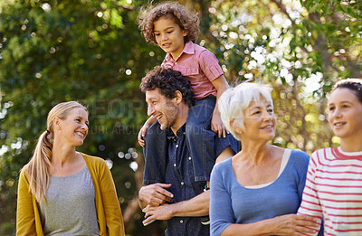 Buy stock photo Shot of a small family enjoying a day in the sun