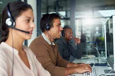 Buy stock photo Shot of call centre agents working in an office