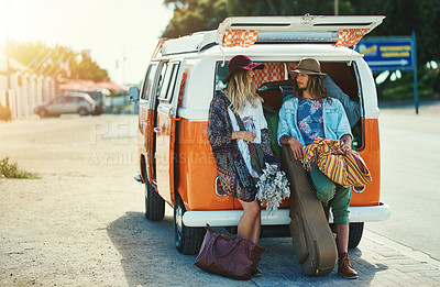 Buy stock photo Shot of a young hipster couple leaning on the back of their camper van