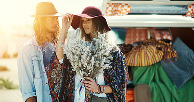 Buy stock photo Cropped shot of young hipster couple standing outside next to a camper van