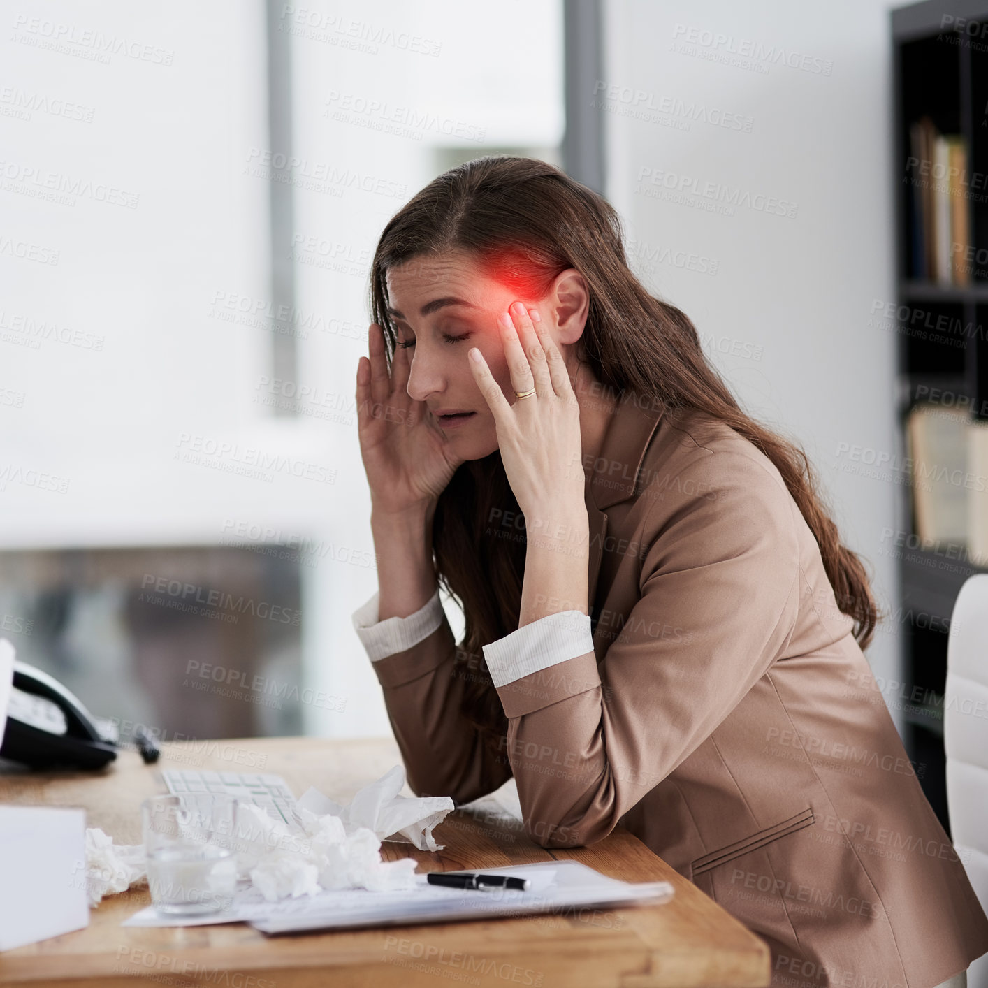 Buy stock photo Shot of a young businesswoman experiencing a headache highlighted in glowing red at work