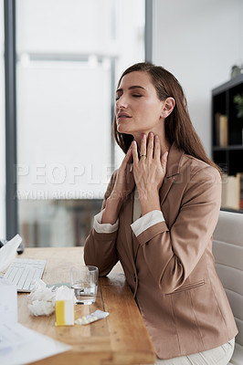 Buy stock photo Shot of a young businesswoman experiencing throat pain while working in an office