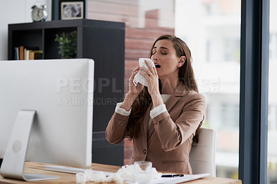 Buy stock photo Shot of a young businesswoman suffering with allergies at work