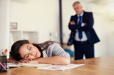 Buy stock photo Cropped shot of a businesswoman sleeping at her desk with her boss standing in the background