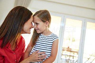 Buy stock photo Shot of a mother and  her young daughter sitting together in the living room at home