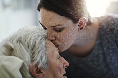 Buy stock photo Shot of a daughter visiting her senior mother in hospital