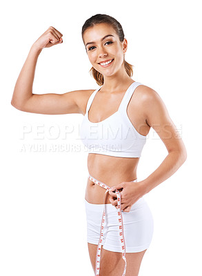 Buy stock photo Cropped shot of a young woman measuring her waist