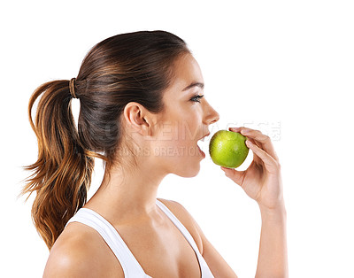 Buy stock photo Cropped shot of a healthy young woman eating an apple