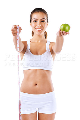 Buy stock photo Portrait of a healthy young woman holding an apple and a measuring tape
