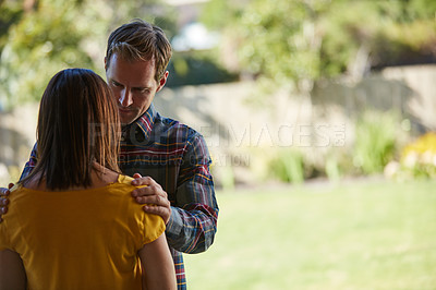 Buy stock photo Cropped shot of a man comforting his wife