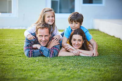 Buy stock photo Shot of a family of four spending time outdoors